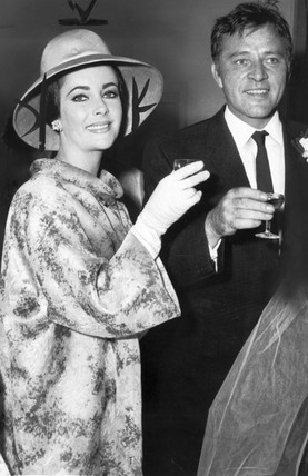 Elizabeth Taylor and Richard Burton at a wedding, August 1963.