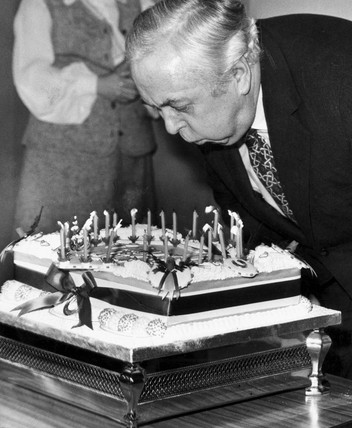 Harold Wilson blowing out candles on a cake, February 1975.