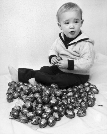 Child with Creme Eggs, Easter, 1980.