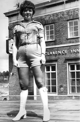 Barmaid in hot pants, 1971.
