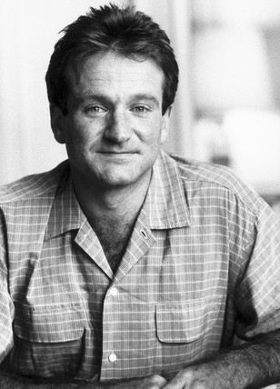 Robin Williams, American actor, 1984.