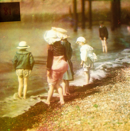 Children paddling at the seaside, late 19th-early 20th century.