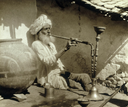 A smoker, Jubbulpore, India, c 1911.