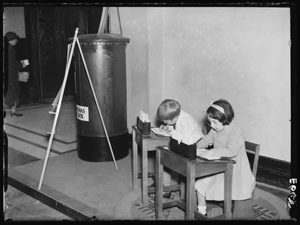 Children writing to Father Christmas, 1934.