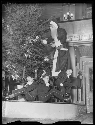 Father Christmas and page boys, 1933.