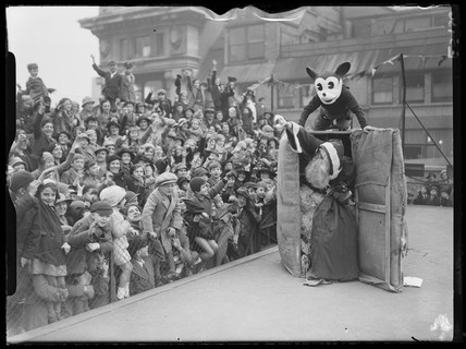 Father Christmas arrives at Selfridges by parcel post, with Mickey Mouse, 1935.