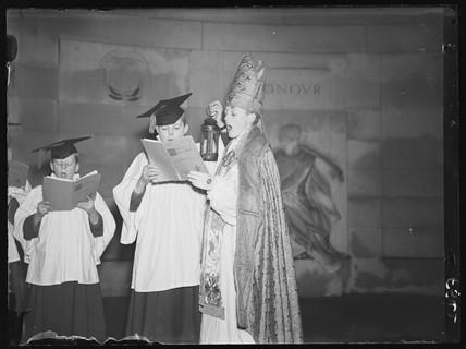 A child bishop and choir sing Christmas carols, 1936.