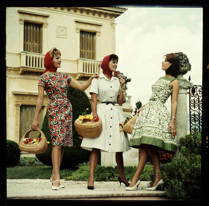 Three women with baskets, 1960s.