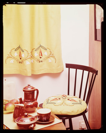 Yellow interior with red coffee set, 1960s.