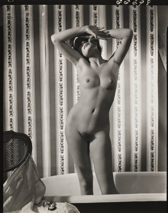 Nude study: woman standing in a bath, 1960s.