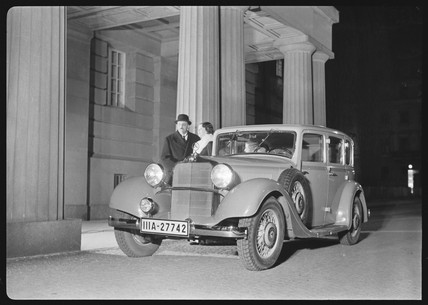 A man and woman with a Mercedes Benz motor car, c 1934.