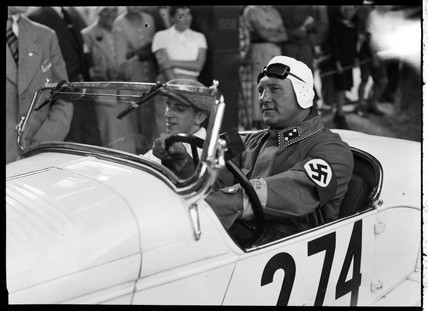 A swastika-wearing driver of a motor racing car, c 1934.