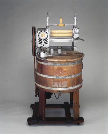 Wooden electrically-driven domestic washing machine, c 1920.