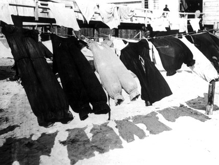 Edwardian bathing costumes drying on a wash