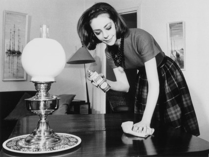 Woman polishing the living room table, 28 May 1963.