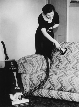 Home cleaning, c 1930s.