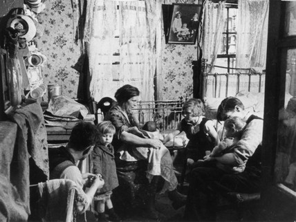 Interior of a slum, London, 1 November 1934.
