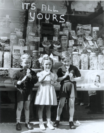 Children buy off-ration sweets, London, 5 February 1953.