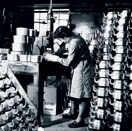 Working at a utensil factory, Warwickshire, 6 April 1945.