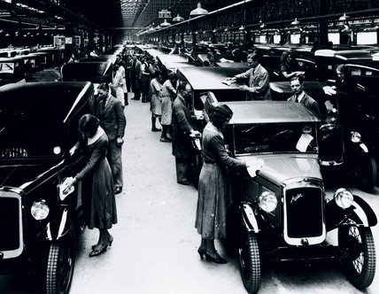 Polishing finished motor cars at the Austin motor car factory, 27 May 1935.
