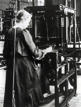 Woman weaving cotton on a hand loom in a cotton mill, c 1890s.
