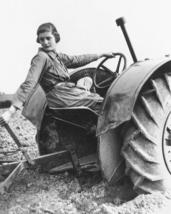 Land girl learning to plough using a tractor, 7 May 1939.