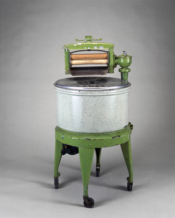 Electric washing machine with wringer attachment, c 1929.