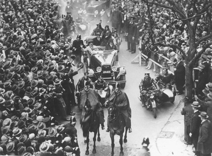 Amy Johnson being driven through crowded streets, Melbourne, 1930.