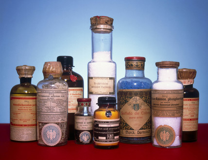 Group of nine bottles containing various chemicals, c 1920s.