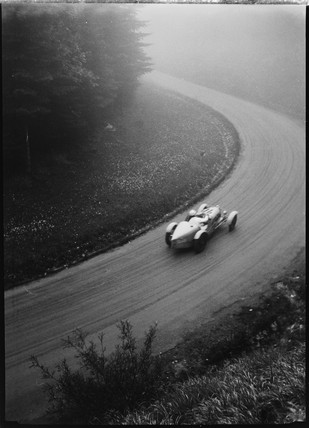 Bugatti Type 53 racing car being driven along a race track, Germany, 1930s.