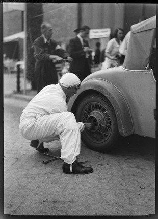 A motor racing car wheel being changed, Germany, c 1934.