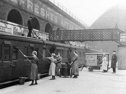 Women cleaning a train, World War One, 1914-1918.