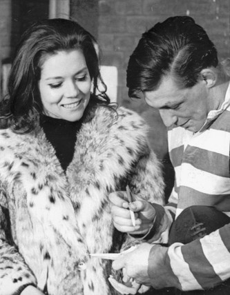 Diana Rigg with a rugby player, December 1965.