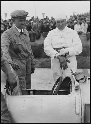 E G Burggaller and mechanic, German Grand Prix, Nurburgring, 1934.