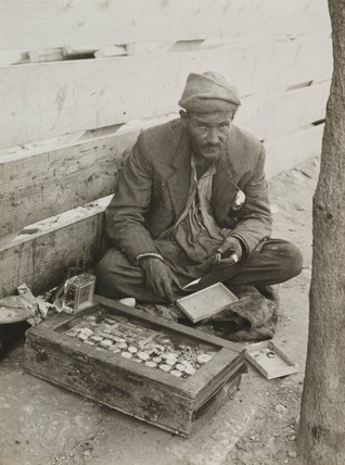 Wandering watchmaker with his workshop, Jerusalem, 1939.