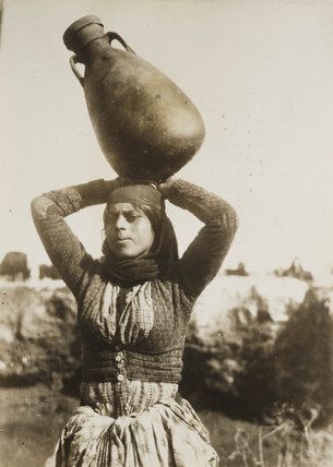 Bedouin woman carrying water, Palestine, 1924.