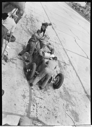 Hans Stuck in the pits, German Grand Prix, Nurburgring, 1934.