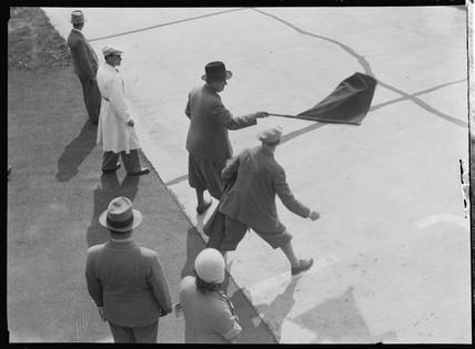 Alfred Neubauer waving the signalling flag, Nurburgring, Germany, 1930s.