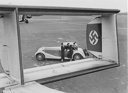 Mercedes-Benz convertible, and swastika on Junkers tailplane, 1930s.