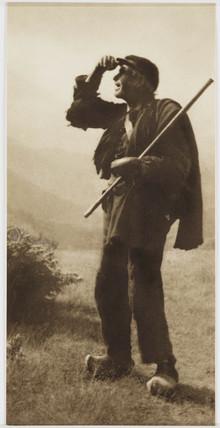 A shepherd in clogs and a flat cap.;