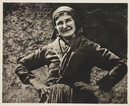 Woman smiling.;