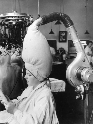 The latest hairdrying technology at a hairdressing school, 8 July 1937.