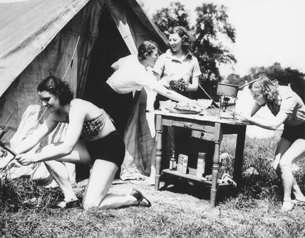 Four women outside a tent during their camping holiday, c 1930s.
