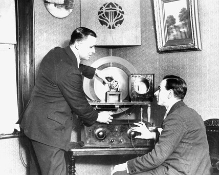 Operating radio equipment, c 1930s.