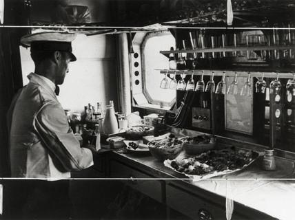 Preparing lunch on the Imperial Airways aeroplane 'Scylla', 19 November 1936.