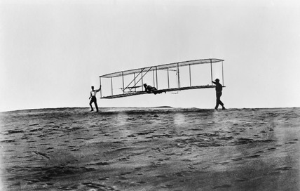 Orville Wright flying a glider at Kitty Hawk, North Carolina, USA, 10 October 1902.