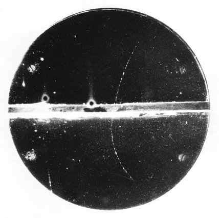 First picture of a positron track, taken by Carl Anderson, 1932.
