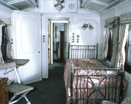 Interior of the Queen's bedroom in the LNWR royal carriage, c 1925.