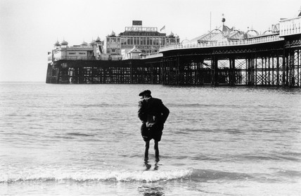 Elderly man paddling at Brighton, 1967.