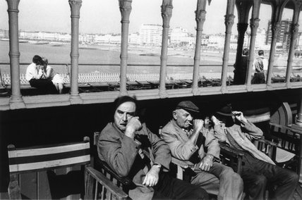 Three elderly males relaxing in chairs, 1968.